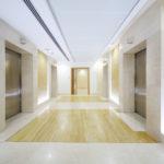 Квартирный и лифтовые портал из искусственного мрамора